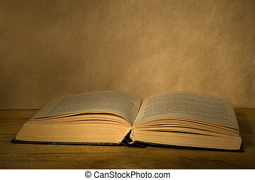 Old open book. - Old open book on a wooden table.