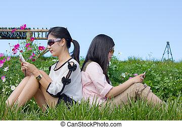cute women use mobilephone