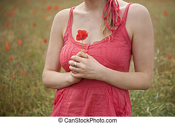 I Will Remember - Young woman in a poppy field