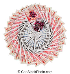 Many 50 pound sterling bank notes with diamonds fanned out,...