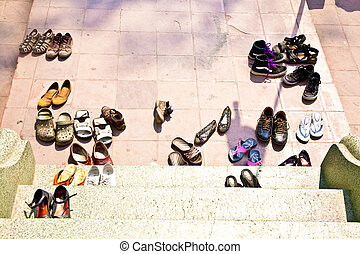 shoes in front of buddhist temple, only barefoot allowed