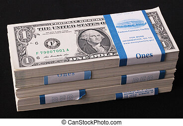 wads - Wads of one-dollar bills on black background