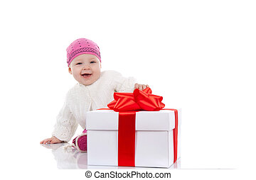 8 month child - year child with gift box over white...