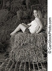 portraite - attractive girl in the hay. rural lifestyle