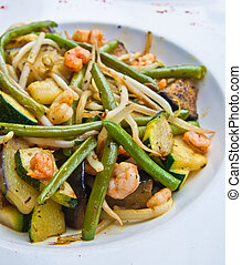 asian cuisine - plate of asian cuisine with beans and peas...