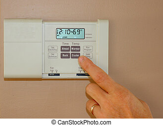 home thermostat to save on energy costs and conserve