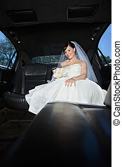 Bride With Flower Bouquet in Limo - Beautiful bride sitting...