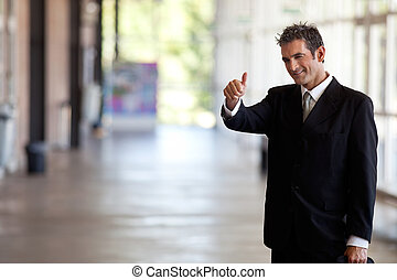 Businessman Gesturing Thumbs Up - Portrait of male...