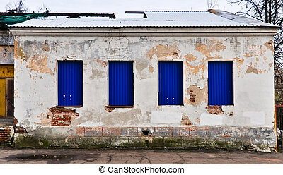 old abandoned wooden white  building