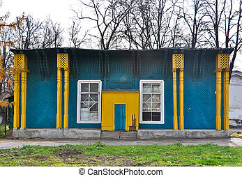 old abandoned wooden yellow blue building