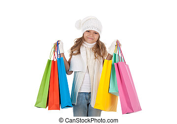 little girl - Little teenage girl with shopping bags over...