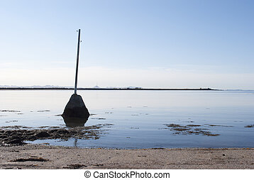 Old Telegraph Pole in Water