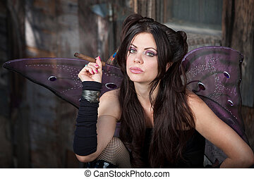 Fairy Holds a Cigar - Beautiful and Caucasian fairy holds a...