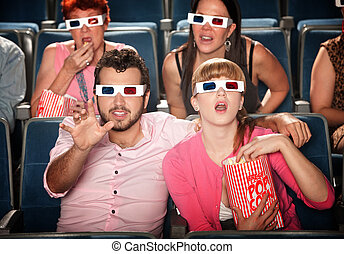 Reaching Out at 3D Movie - Amazed Caucasian couple with 3D...