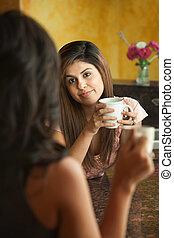 Women Socialize in Kitchen