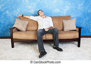 Bored Man - Bored young Caucasian man on sofa looks up