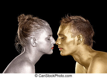 bodypainted faces - gold and silver bodypainted faces of a...