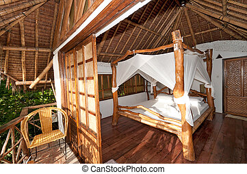 Romantic hotel room - Romantic bed in a tropical hotel