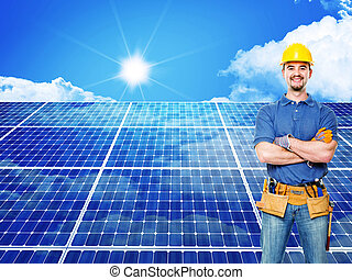solar power - standing worker and solar panel background