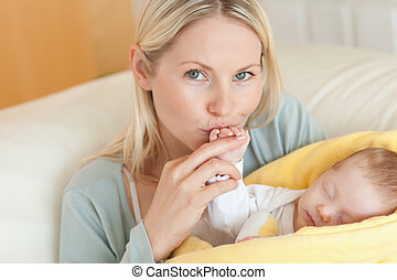 Mother enjoys being with her baby - Young mother enjoys...