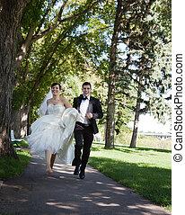 Bride and Groom Running - Happy bride and groom running...