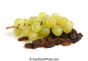 Bunch of grapes and raisins on a white background
