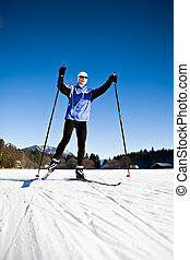 cross-country skiing - A woman cross-country skiing in the...