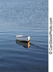 solitary rowing boat - Lonely white rowing boat