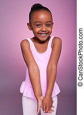 Cute little African American girl wearing a ballet costume -...