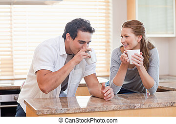 Couple drinking coffee in the kitchen