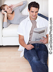 Couple enjoying their spare time in the living room - Young...