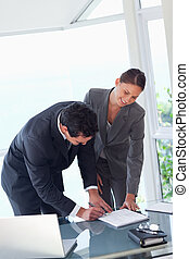 Business partners signing contract - Young business partners...