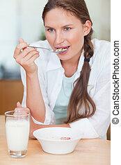 Portrait of a beautiful woman having breakfast