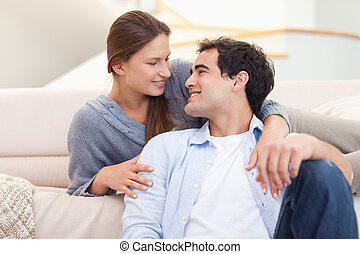 Young couple sitting in their living room