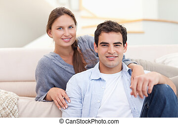 Couple sitting in their living room