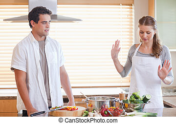 Couple having a disagreement in the kitchen