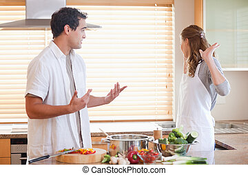 Couple has a tensed situation in the kitchen - Young couple...