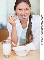 Portrait of a cute woman having breakfast