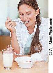 Portrait of a calm woman having breakfast