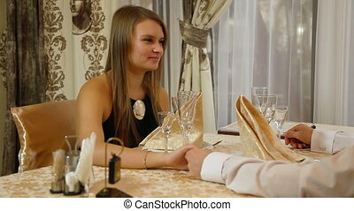 Young people having dinner on romantic date