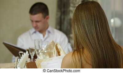 couple dinner in a restaurant - young couple dinner in a...