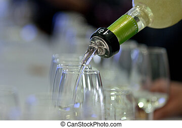 Glasses of catavino for txakoli - Pouring txakoli in a...