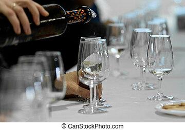 Glasses of catavino for txakoli - Pouring txakoli in a...