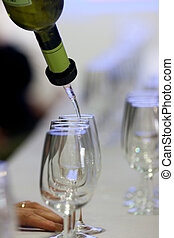 Glasses for wine called catavinos - Pouring txakoli in a...