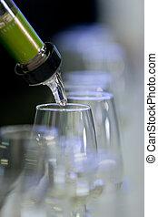 Pouring txakoli in a catavinos - Pouring txakoli in a...