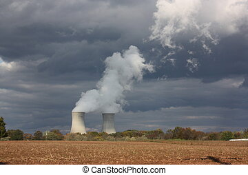 Cooling Towers Approaching Storm - Nuclear energy generating...