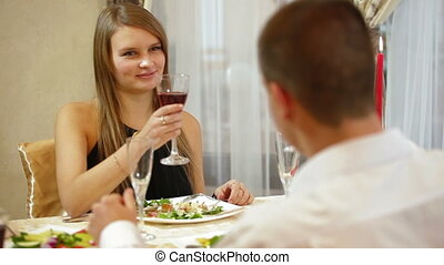 couple toasting at a restaurant table