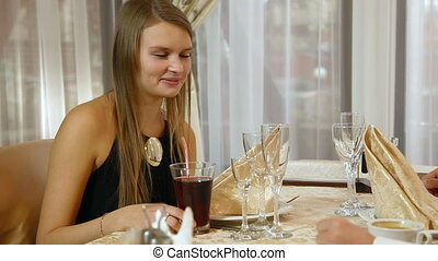 Dinner - Young woman dining in restaurant