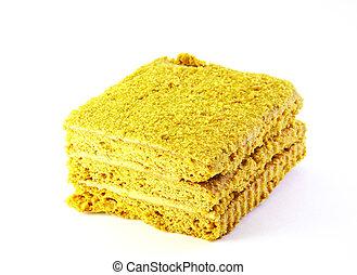 Piece honey cake on white background