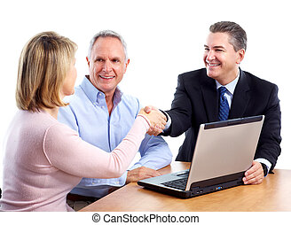 Senior couple with financial adviser - Senior couple with a...